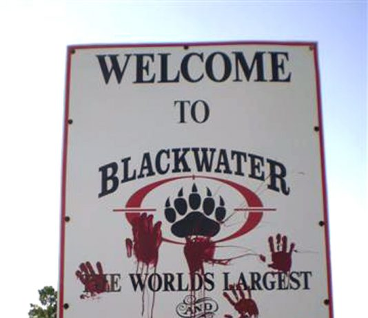 Logo outside the Blackwater HQ with bloody hand stains on it