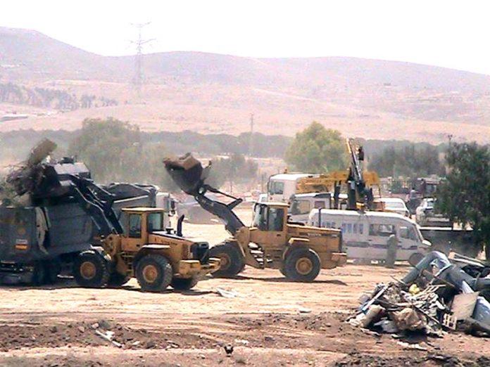 Israeli bulldozers at work demolishing the Bedouin village of al-Araqib in the Negev