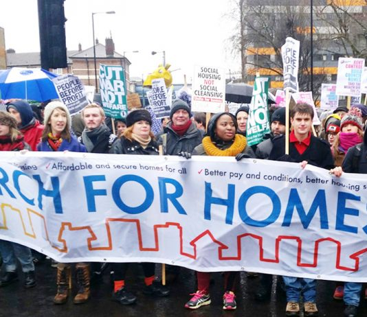 Workers on a defend council housing march to London's City Hall in January fighting against government cuts to housing and mass evictions