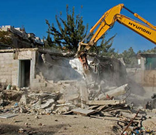 Israeli bulldozers razing the homes of Palestinians