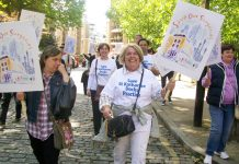 Patients, GPs and staff marching through Tower Hamlets to defend 21 east London GP surgeries threatened with closure