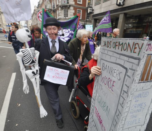 Marchers on a TUC demonstration against austerity demand jail for the bankers