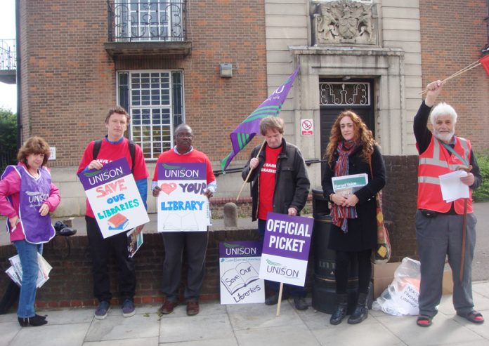 Pickets outside East Finchley library yesterday during the first day of their two-day strike action against cuts and privatisation