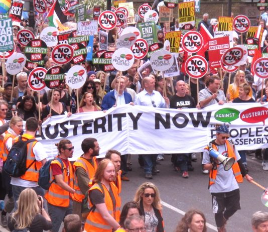 The lead banner 'End Austerity Now' is carried by trade union leaders, including Unite's Len McCluskey (centre)