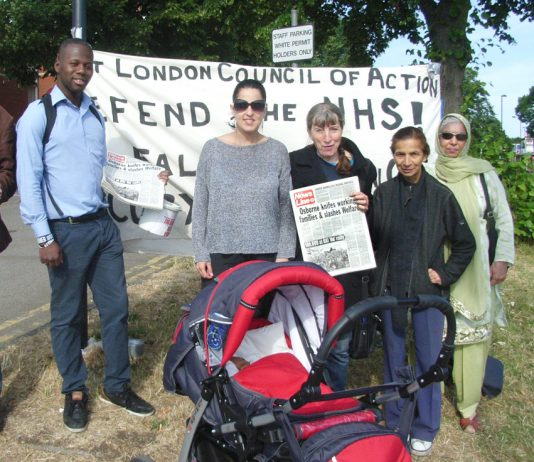 Young mother GLEISA LIMA with her one month-old baby Victoria joined the West London Council picket of Ealing Hospital to demand the hospital's Maternity Department be reopened
