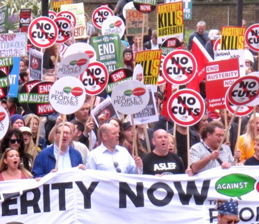 MICK WHELAN, Aslef general secretary (ASLEF T-shirt) and Unite leader LEN McCLUSKEY (3rd from left) at the front of the National Austerity Protest last