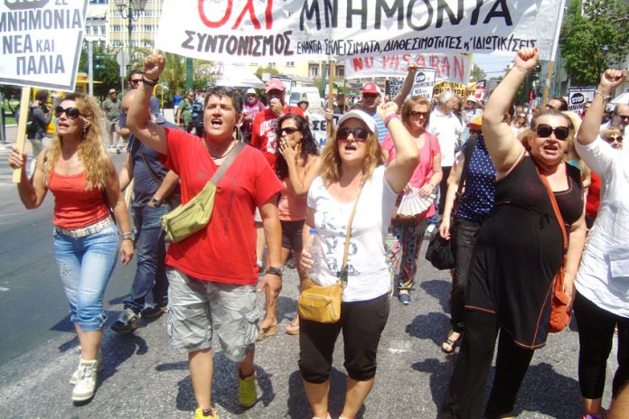 Sacked Finance Ministry cleaners marching in Athens