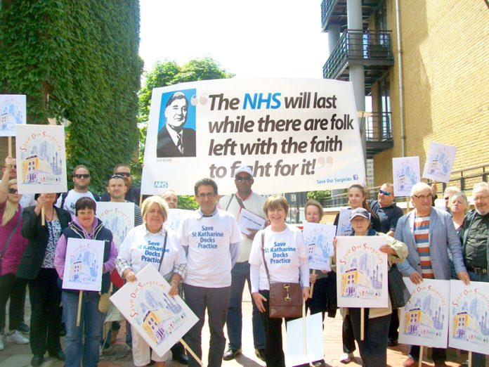 Doctors march in defence of surgeries in east London