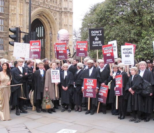 Barristers and solicitors demonstrated outside Parliament during a strike last year against legal aid cuts