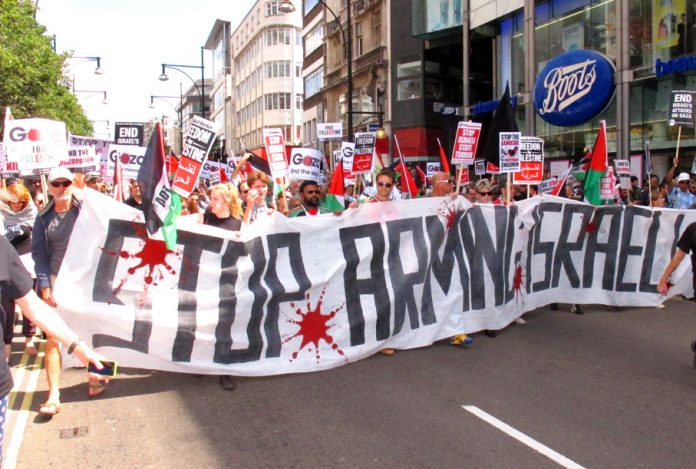 Demonstrators in London during the Israeli bombardment of Gaza demanding a halt to the arming of Israel