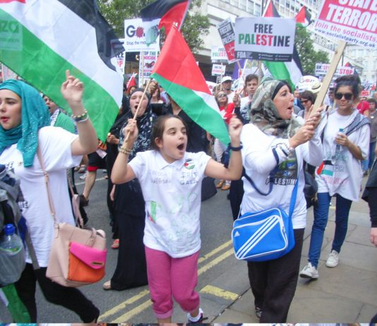 Young people marching to the Israeli Embassy in London to denounce Israeli war crimes in Gaza
