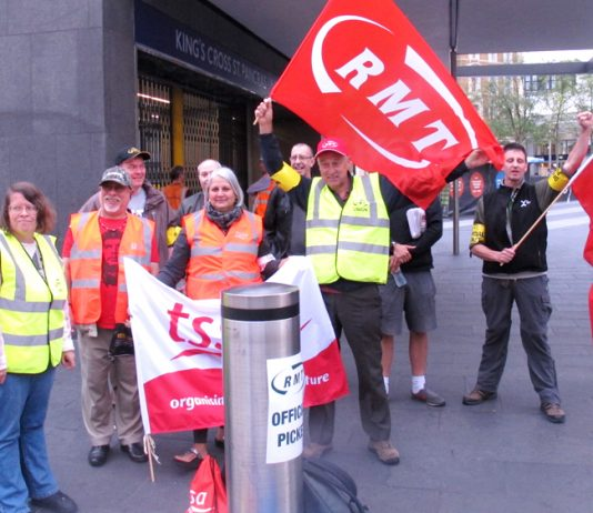 Above: Pickets at King's Cross station were in a determined mood with one picket stating 'we need a general strike against austerity'.