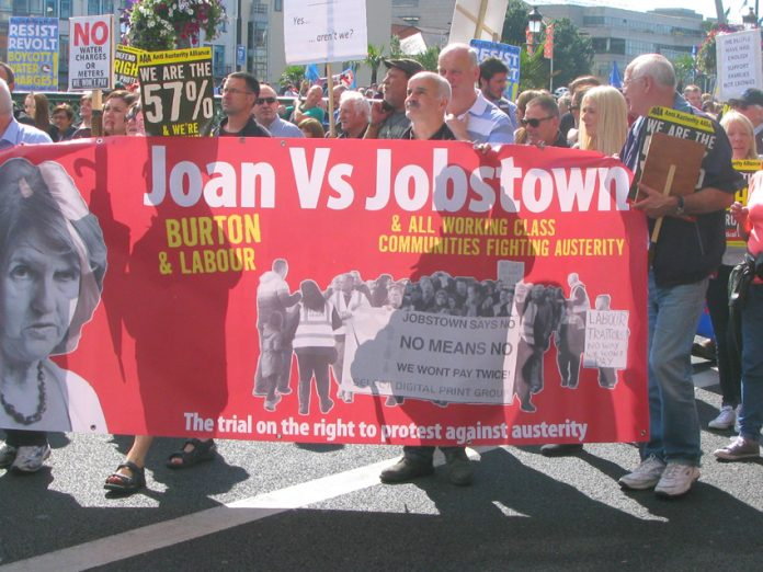 Banner on Saturday's march condemning Labour leader Joan Burton after scores of water charge demonstrators were arrested in Jobstown last November