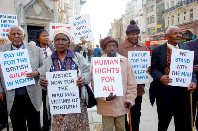 Kenyan Mau Mau veterans picket the law courts in the Strand in London, England as a successful legal case is brought against the UK government