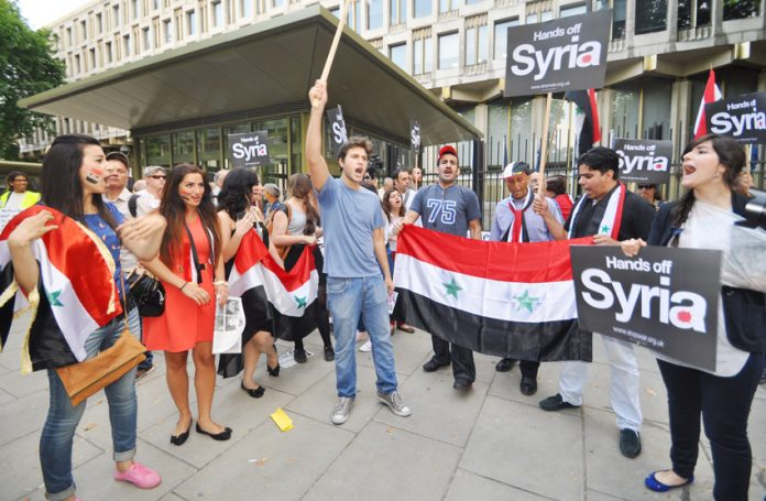 Syrians outside the US embassy in London demanding no imperialist intervention in Syria