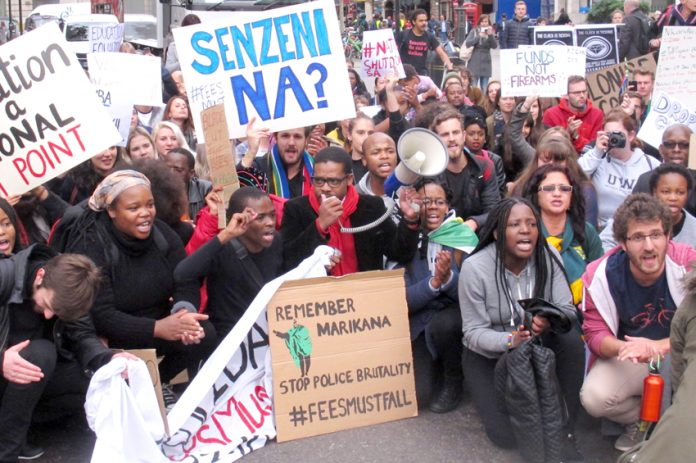 South African students in a sit-down protest outside the South African embassy demanded an end to police brutality against protesting students in South Africa