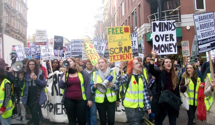 Marchers at the front of Wednesday's 10,000-strong demonstration against tuition fees demanding the restoration of student grants