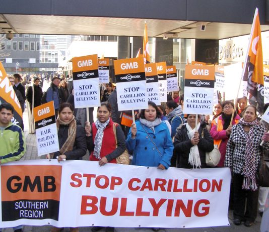 Swindon Hospital Carillion workers demonstrate outside the company's HQ in London against the company's work practices