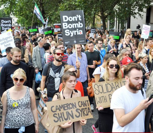Tens of thousands marched on September 12th to welcome refugees into Britain and demand that Britain must not bomb Syria