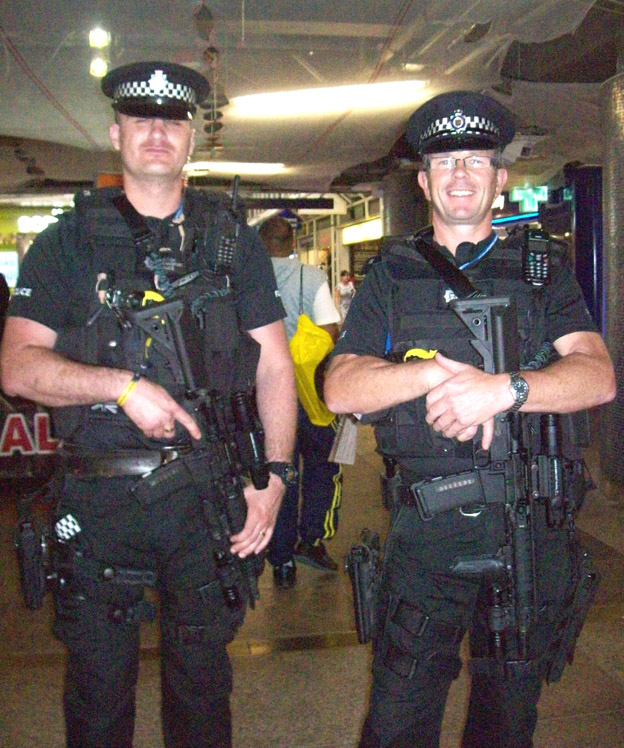Heavily armed police with sub-automatic MP4 weapons at Liverpool St station in central London