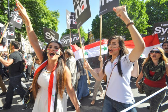 Syrian students on the mass march in central London against the UK bombing of Syria – Cameron wants another vote in parliament