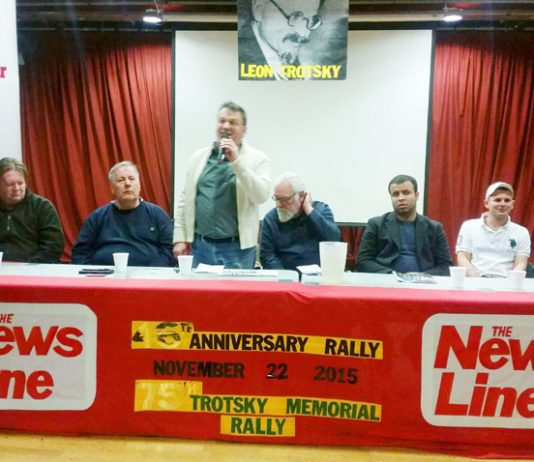 Platform at the News Line Anniversary Meeting (L-R) JOSHUA OGUNLEYE, Young Socialists National Secretary, IAN HODSON, BFAWU National President; BILL ROGERS, Aslef; FRANK SWEENEY, WRP; DAVE WILTSHIRE, ATUA; FUAD SHAATH, General Union Palestinian Students;