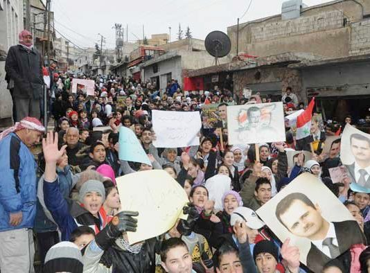 Syrian youth show their support for President Assad
