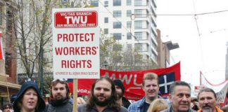 TWU members marching against government attacks – the union is demanding $1 million is returned to it