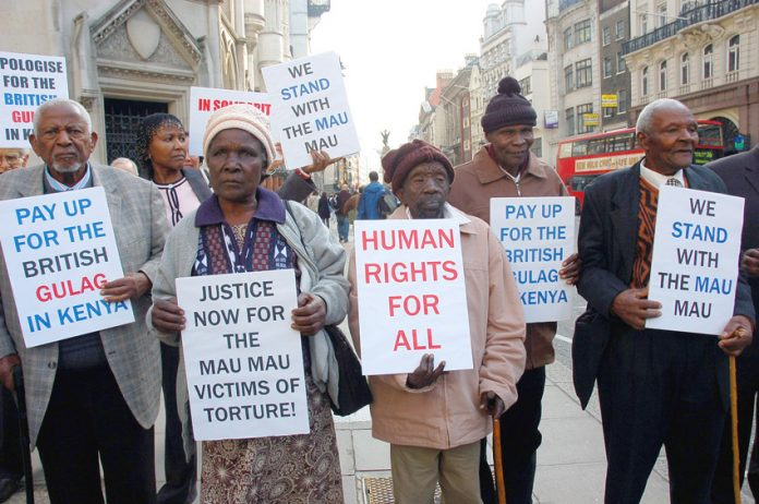Mau Mau detainees outside London's High Court recently won massive compensation for British army atrocities committed against them
