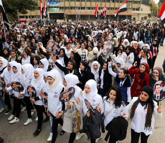Syrian schoolgirls show their support for President Assad on Army Day