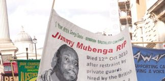 The banner of Jimmy Mubenga a 46-year-old Angolan who died after being forcibly restrained by G4S guards as he was being deported on a flight to Angola in October 2010