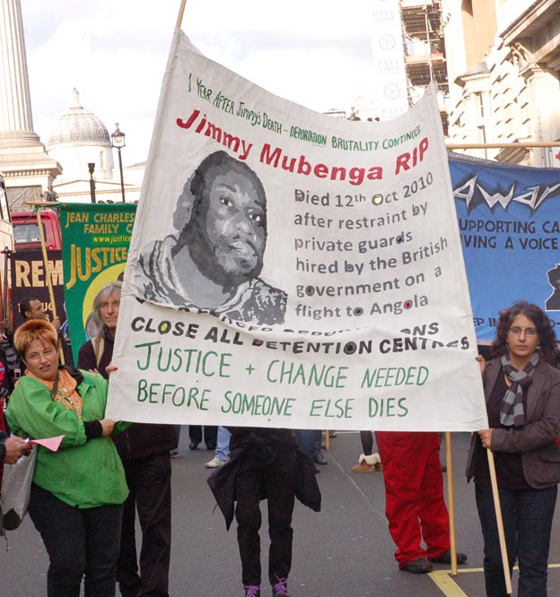 The banner of Jimmy Mubenga, a 46-year-old Angolan who died after being forcibly restrained by G4S guards as he was being deported on a flight to Angola in October 2010
