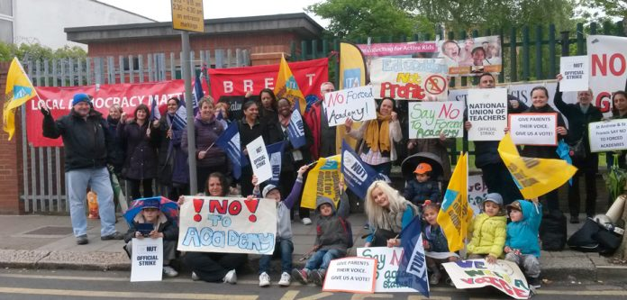 Pupils, parents and teachers demonstrated outside St Andrew & St Francis Primary School during a teachers' strike against the school being forced to become an academy