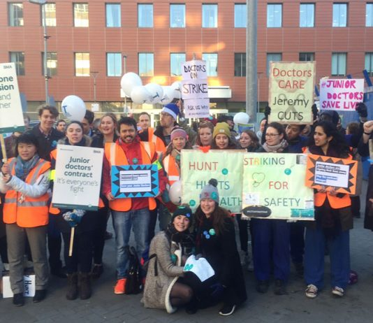 CAM STOCKS (far right in hat) joins junior doctors, nurses and supporters on the picket line outside the Royal London Hospital in Whitechapel, east London during last Tuesday's strike