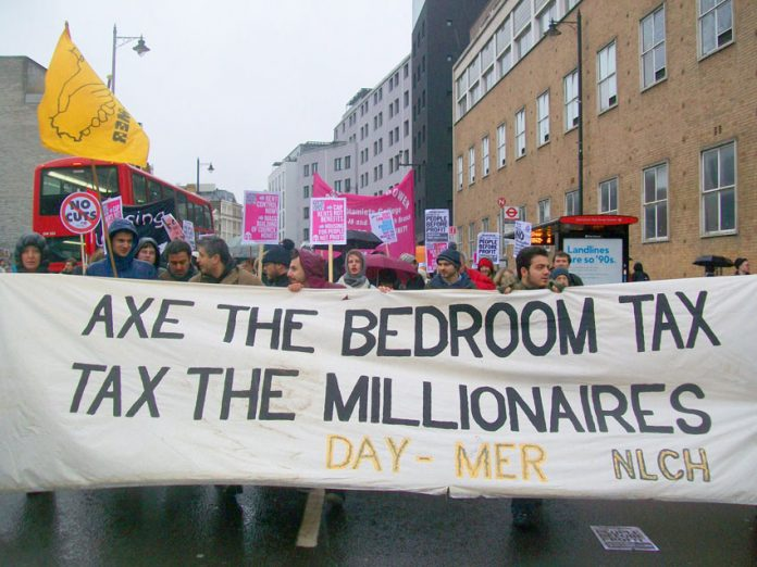 'Axe the Bedroom Tax' banner on a march for more council homes in London