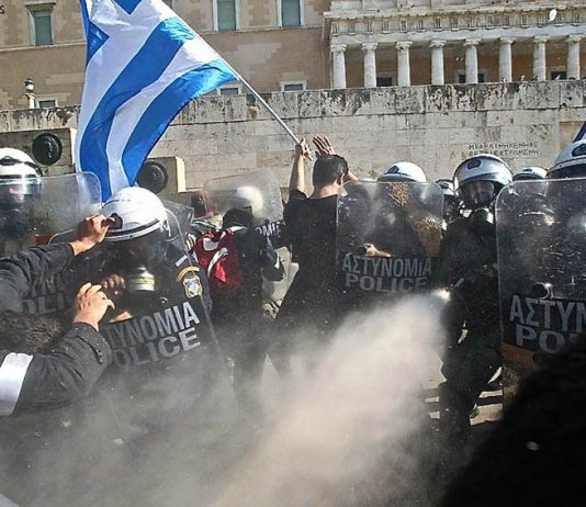 Greek farmers attacked by riot police while protesting against a massive attack on pensions imposed on Greece by the European Union Photo credit: Marios Lolos