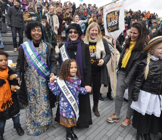 HELEN PANKHURST, great-granddaughter of suffragette founder, Emmeline (centre left, in hat) next to RACHEL HOLMES  (centre, author of 'Eleanor Marx: A Life') with the crowd at the 'Walk in Her Shoes' rally
