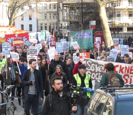 A section of the 10,000-strong 'Kill the Bill' march as it entered the Strand yesterday