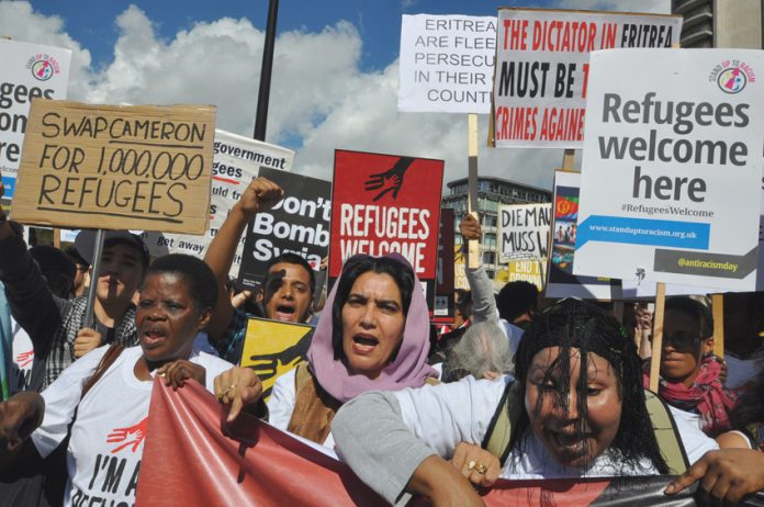 100,000-strong 'Refugees Welcome' march proposes a different kind of deal for Cameron
