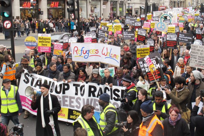 The front banner on Saturday's 8,000-strong 'Stand up to Racism, Refugees Welcome' demonstration