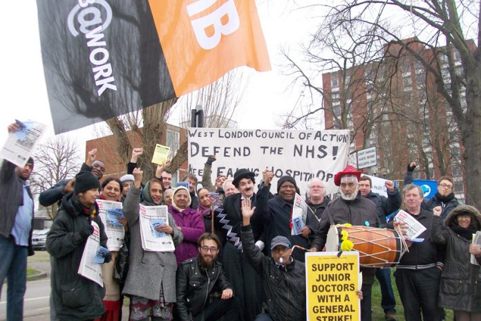 Traditional Indian Dhol drum beat to the rhythm of the 50-strong picket's chants of 'Hands off Charlie Chaplin Ward! Save Ealing Hospital!'
