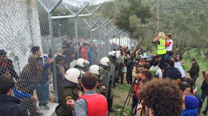 Refugees in the Moria camp are in a prison until they are to be moved out of Greece by the police and army. Photo credit: left.gr