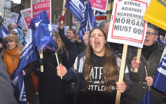 Teachers vent their anger last Wednesday night outside the Department of Education