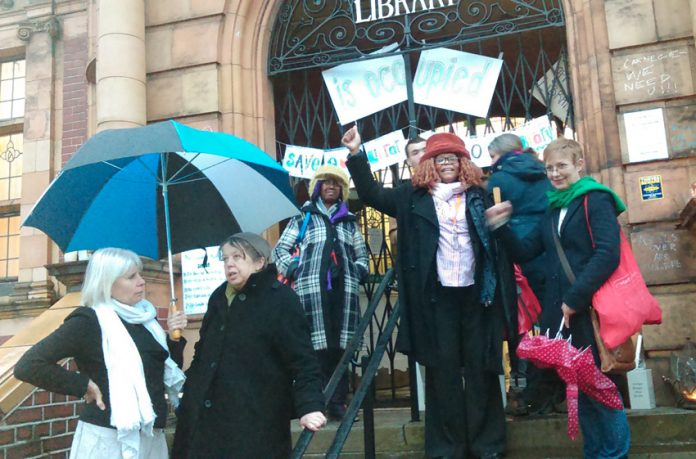 Supporters of the Carnegie Library in Lambeth gather outside on Saturday night in support of the round-the-clock occupation inside the building