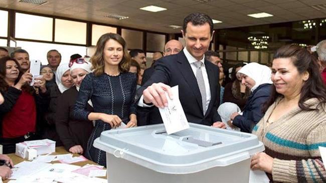 President ASSAD and his wife ASMA vote in Damascus
