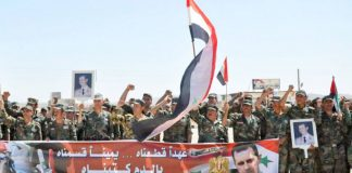 Syrian troops celebrate on the 70th anniversary of Evacuation Day
