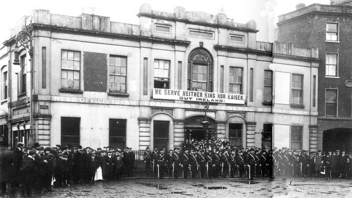 The Irish Citizens Army on parade outside Liberty Hall with their famous 'We serve neither King nor Kaiser' banner