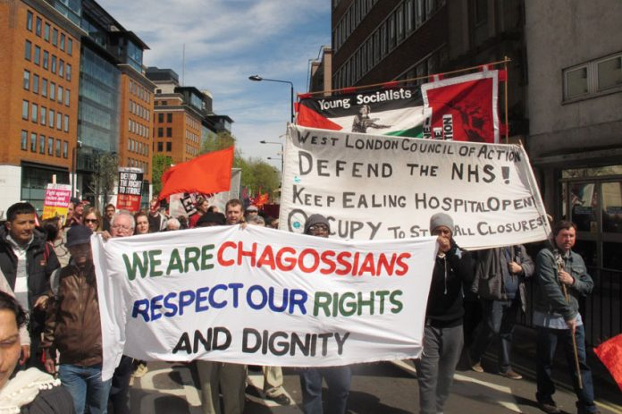 Chagossians demanding the right to return to their homes in the Indian Ocean island of Diego Garcia marching alongside the West London campaign to keep Ealing Hospital open