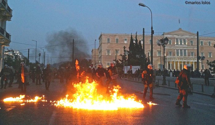 Greek riot police on Sunday night attacked protesters, who fought back with petrol bombs in scenes which resembled a war zone. Photo credit: MARIOS LOLOS
