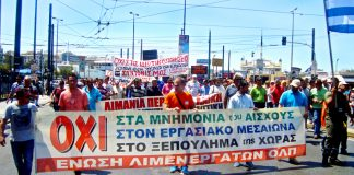 Striking dock workers march in the port of Piraeus